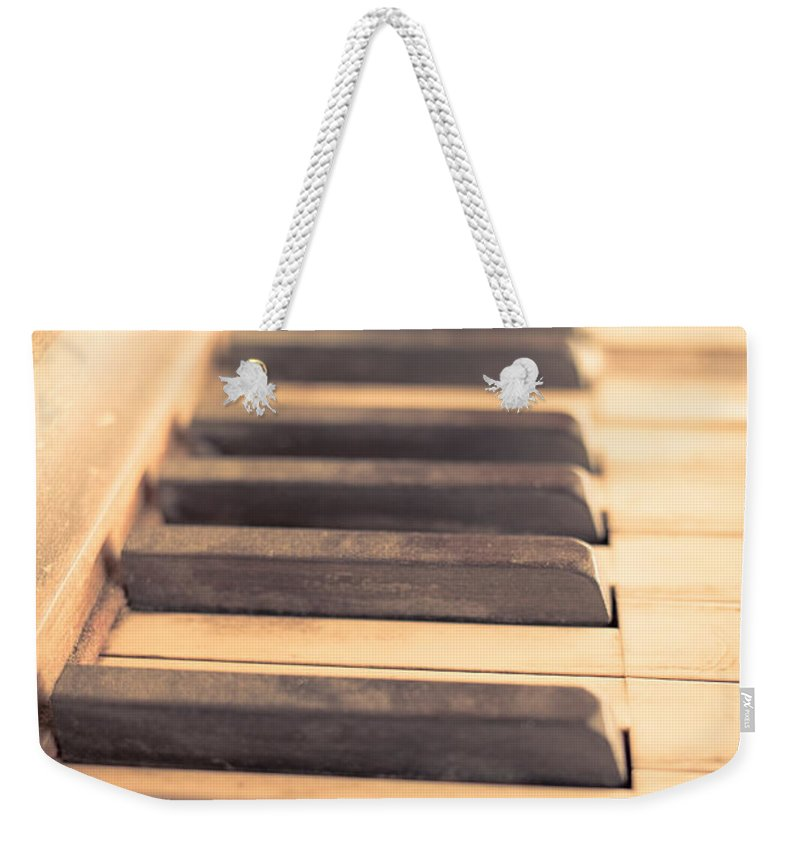 Piano Weekender Tote Bag featuring the photograph Old Piano Keys by Edward Fielding