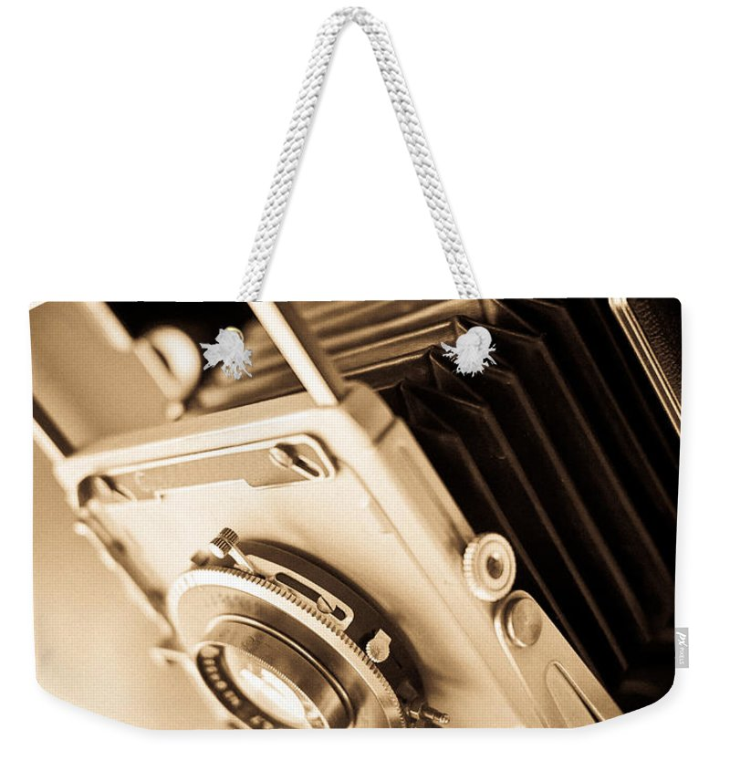 View Weekender Tote Bag featuring the photograph Old Press Camera by Edward Fielding