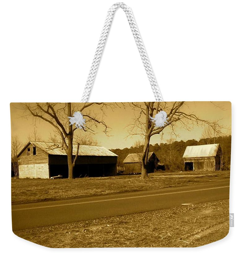 Old Weekender Tote Bag featuring the photograph Old Red Barn In Sepia by Chris W Photography AKA Christian Wilson