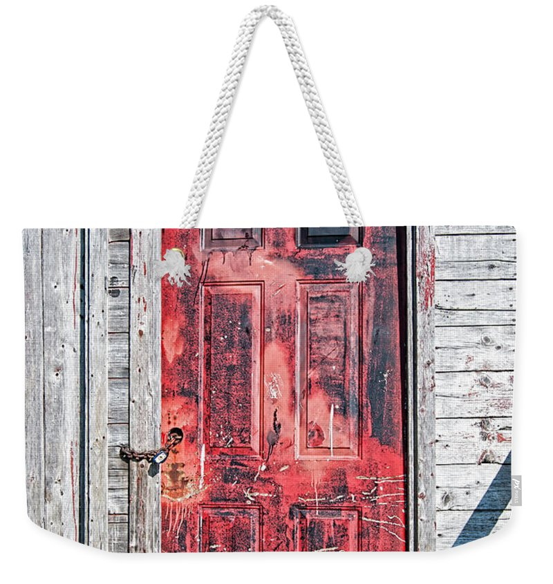 Newfoundland Weekender Tote Bag featuring the photograph Old Red Door by Boss Photographic