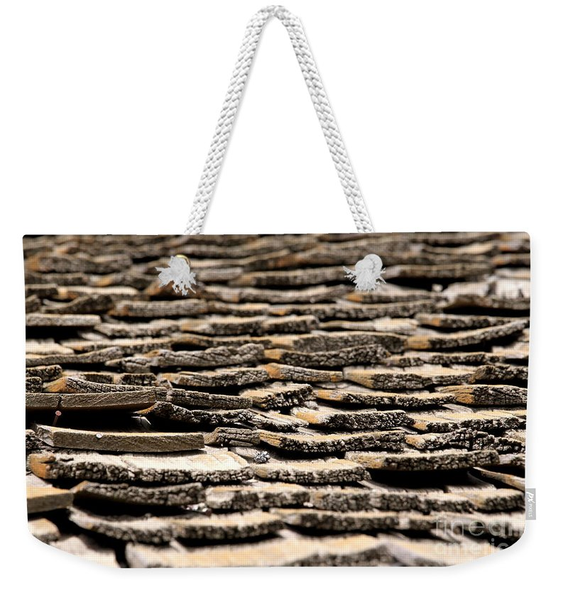 Rotted Weekender Tote Bag featuring the photograph Old Roof by Henrik Lehnerer