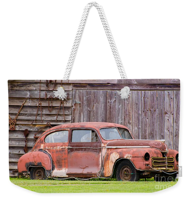 Rusty Weekender Tote Bag featuring the photograph Old Rusty Car by Les Palenik