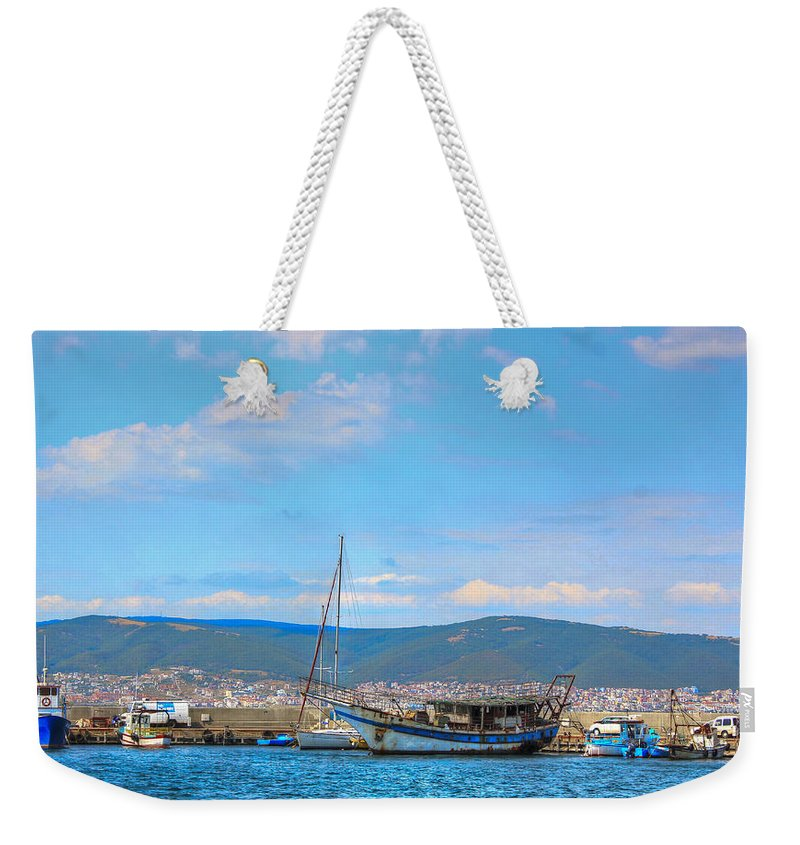 Ship Weekender Tote Bag featuring the photograph Old Ship Skeleton by Eti Reid