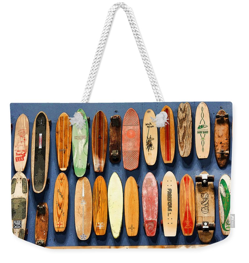 Skateboard Weekender Tote Bag featuring the photograph Old Skateboards On Display by Jan Garcia