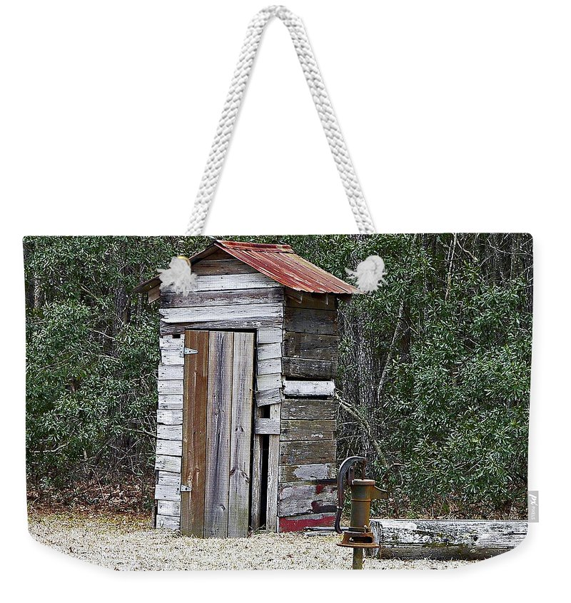 Outhouse Weekender Tote Bag featuring the photograph Old Time Outhouse And Pitcher Pump by Al Powell Photography USA