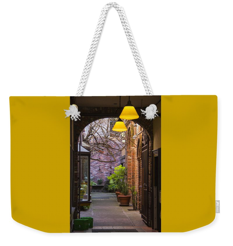 Archway Weekender Tote Bag featuring the photograph Old Town Courtyard In Victoria British Columbia by Ben and Raisa Gertsberg