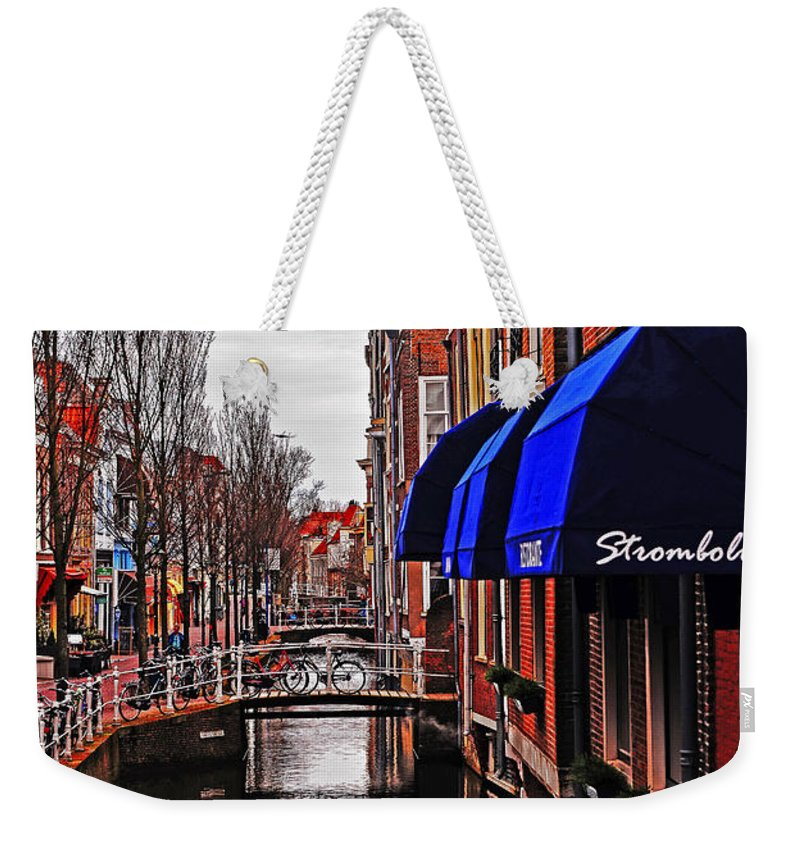 Travel Weekender Tote Bag featuring the photograph Old Town Delft by Elvis Vaughn