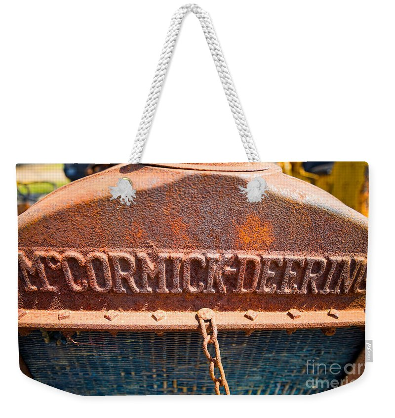 Old Weekender Tote Bag featuring the photograph Old Tractor Grille by Les Palenik