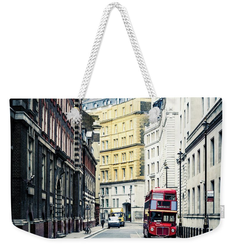 Downtown District Weekender Tote Bag featuring the photograph Old Vintage Red Double Decker Bus In by Zodebala