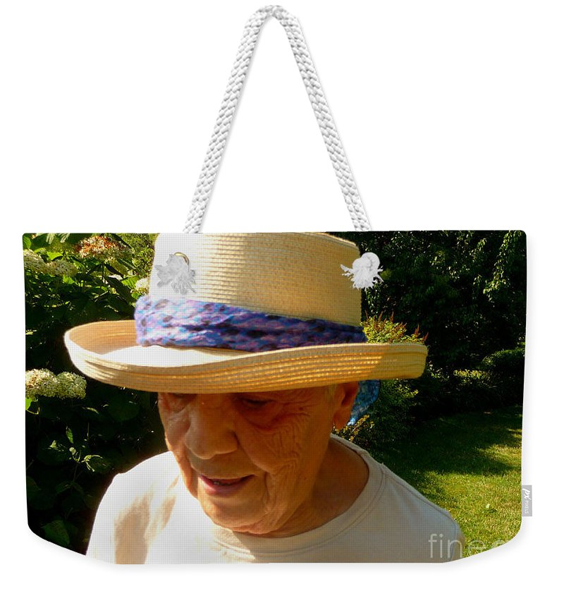 Old Woman Weekender Tote Bag featuring the photograph Old Woman Wearing Straw Hat by Afroditi Katsikis