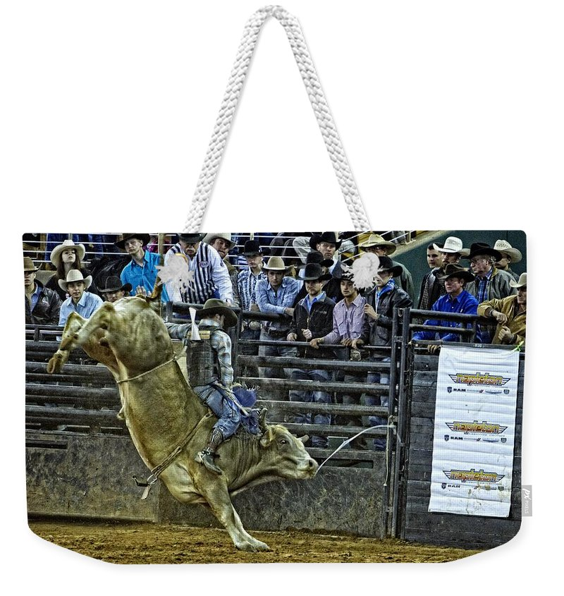 Bullriding Weekender Tote Bag featuring the photograph Ole Lefty by Alice Gipson