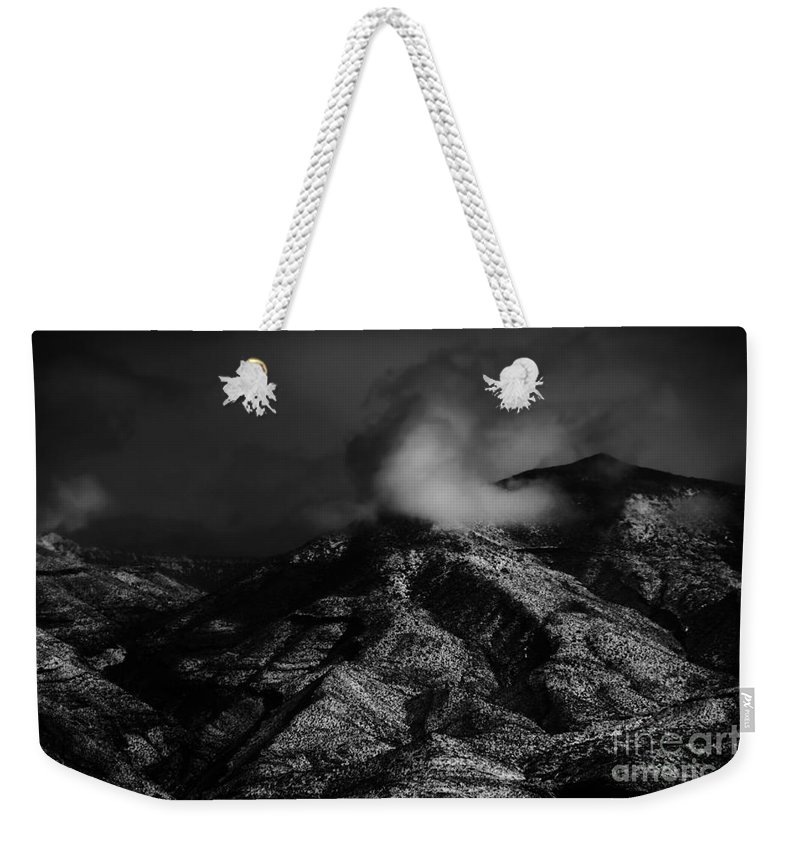 Black Weekender Tote Bag featuring the photograph Ominous by Jessica Shelton