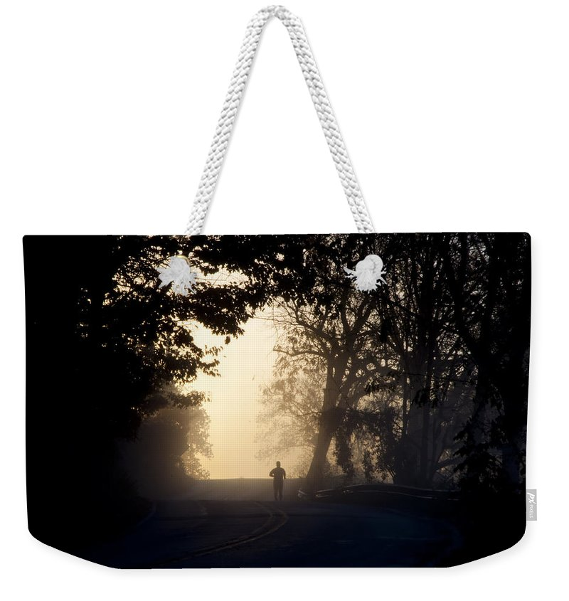 On A Weekender Tote Bag featuring the photograph On A Morning Jog by Bill Cannon