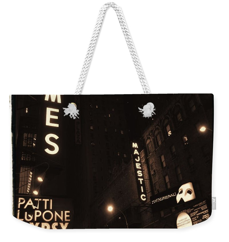 New York Weekender Tote Bag featuring the photograph On Broadway by Donna Blackhall