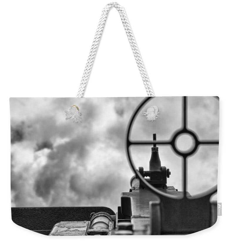 Mechanics Weekender Tote Bag featuring the photograph On Target by Douglas Barnard