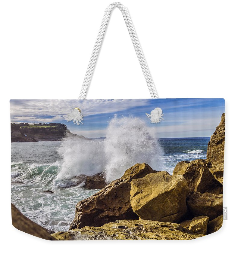 Background Weekender Tote Bag featuring the photograph on the beach in San Sebastian by Snezhana Mayorova