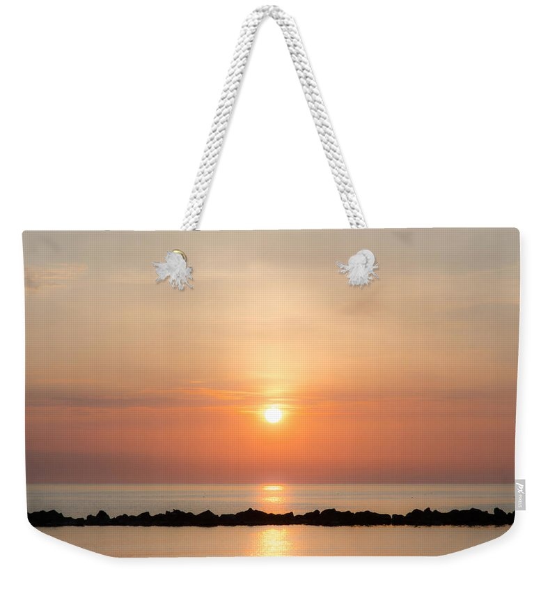 Sunrise Weekender Tote Bag featuring the photograph On The Edge Of Paradise by Andrea Mazzocchetti