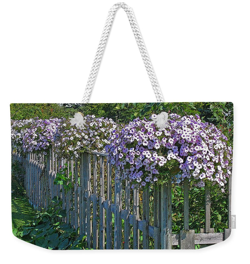 Petunia Weekender Tote Bag featuring the photograph On The Fence by Ann Horn