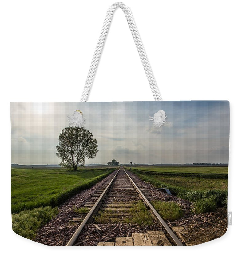 Railroad Weekender Tote Bag featuring the photograph On The Right Track by Aaron J Groen