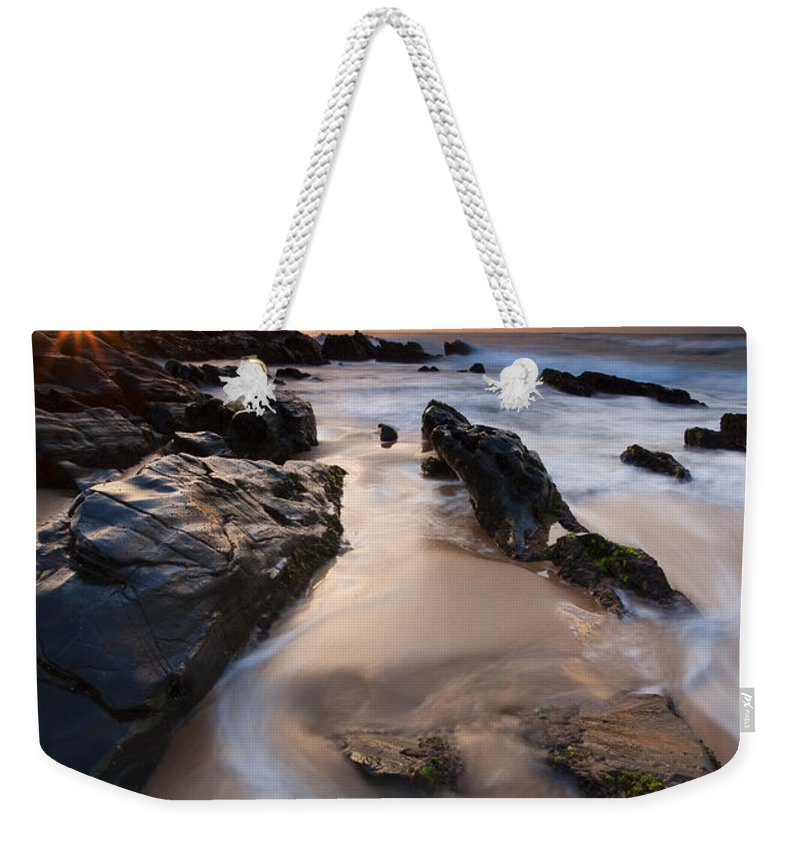 Basham Beach Weekender Tote Bag featuring the photograph On The Rocks by Mike Dawson