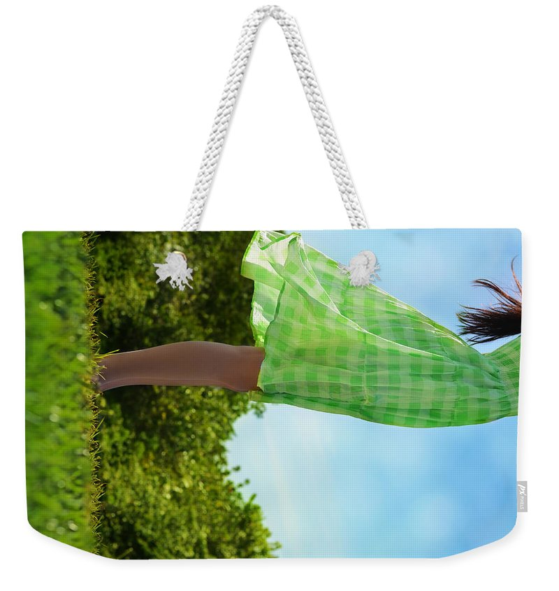 Laura Fasulo Weekender Tote Bag featuring the photograph On This Spinning Earth by Laura Fasulo