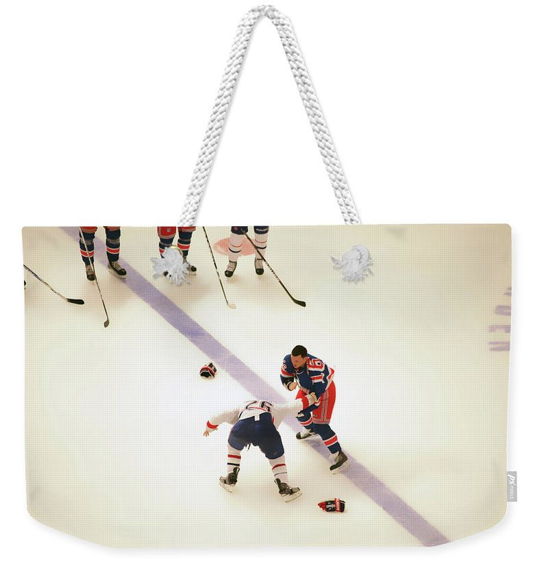 Hockey Weekender Tote Bag featuring the photograph One Two Punch by Karol Livote