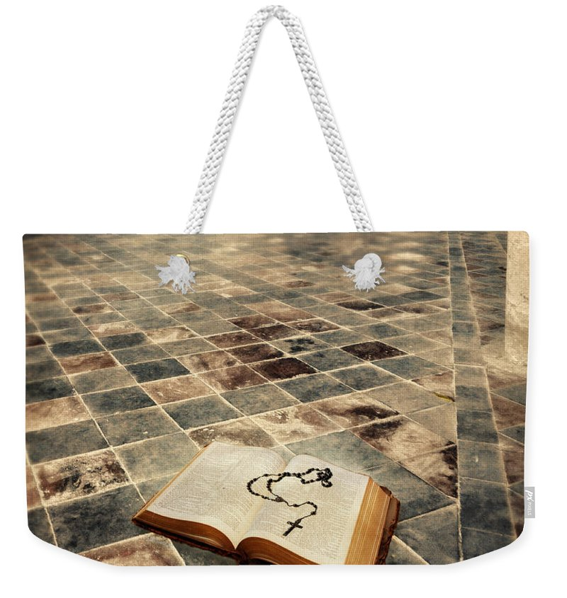 Gothic Weekender Tote Bag featuring the photograph Open Book And Roasary On The Floor by Jill Battaglia