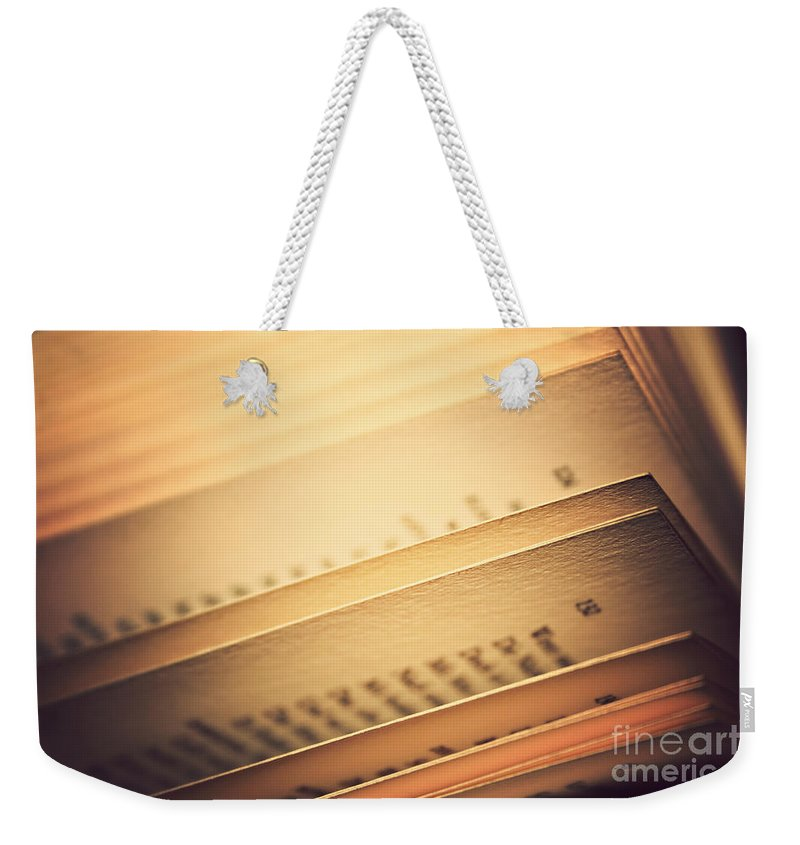 Abstract Weekender Tote Bag featuring the photograph Open Vintage Book by Dan Radi
