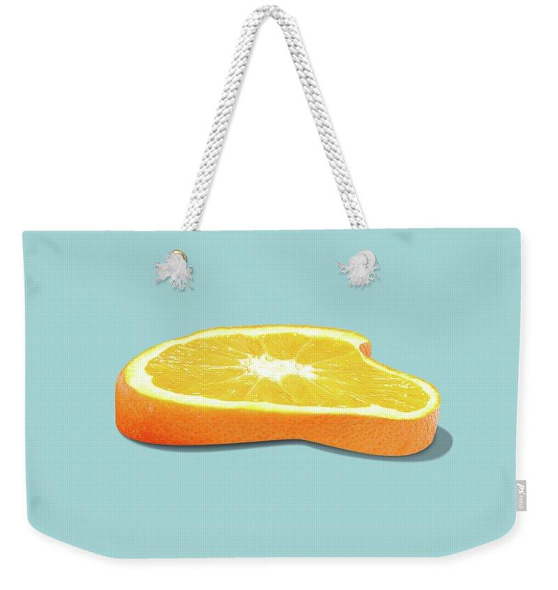 Orange Weekender Tote Bag featuring the photograph Orange Fruit Slice by Dan Cretu