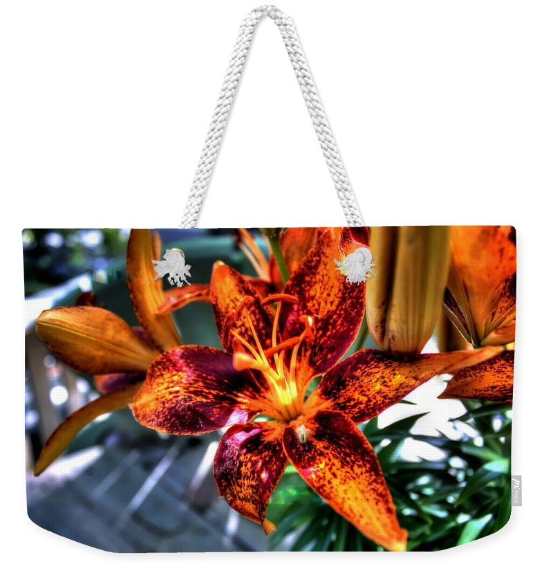 Lilly Weekender Tote Bag featuring the photograph Orange Lilly by Debra Forand
