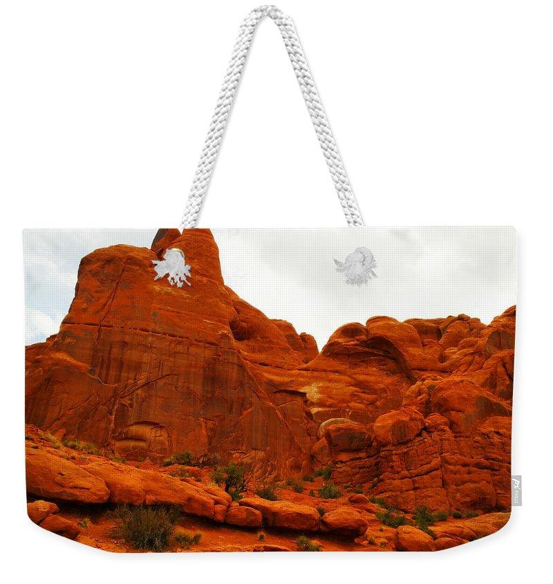 Orange Weekender Tote Bag featuring the photograph Orange Rock by Jeff Swan