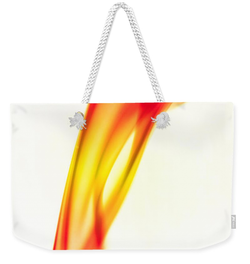 Smoke Abstract Weekender Tote Bag featuring the photograph Orange Smoke Abstract On A White Background by Michalakis Ppalis