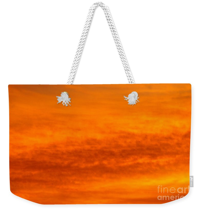 Morning Clouds Of Orange Weekender Tote Bag featuring the photograph Orange Sunrise by Jeffery L Bowers