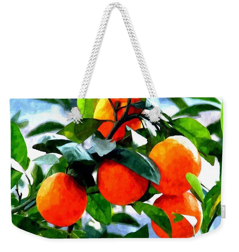 Agricultural Weekender Tote Bag featuring the painting Orange Tree In Springtime by Jeelan Clark