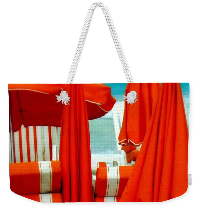 Umbrellas Weekender Tote Bag featuring the photograph Orange Umbrellas by Karen Wiles