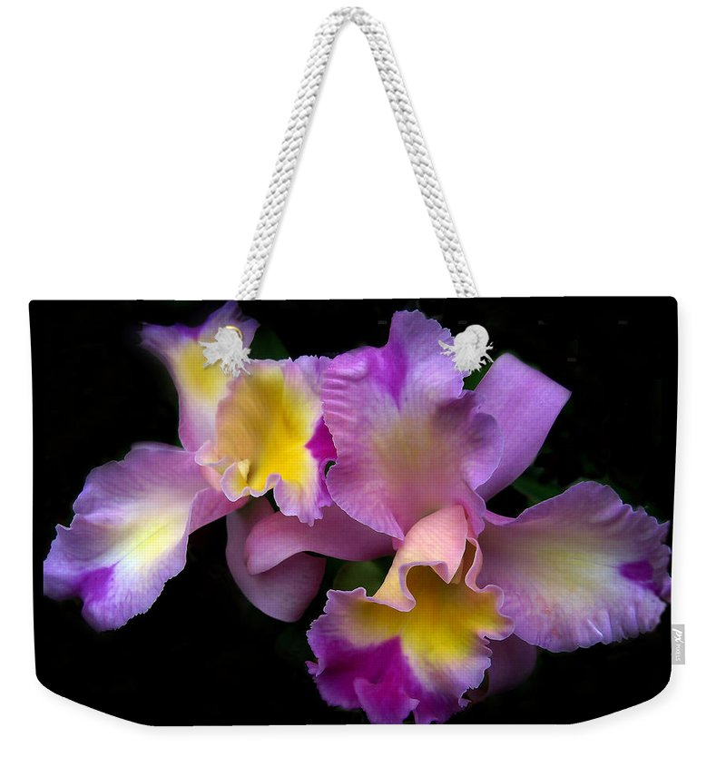 Flowers Weekender Tote Bag featuring the photograph Orchid Embrace by Jessica Jenney