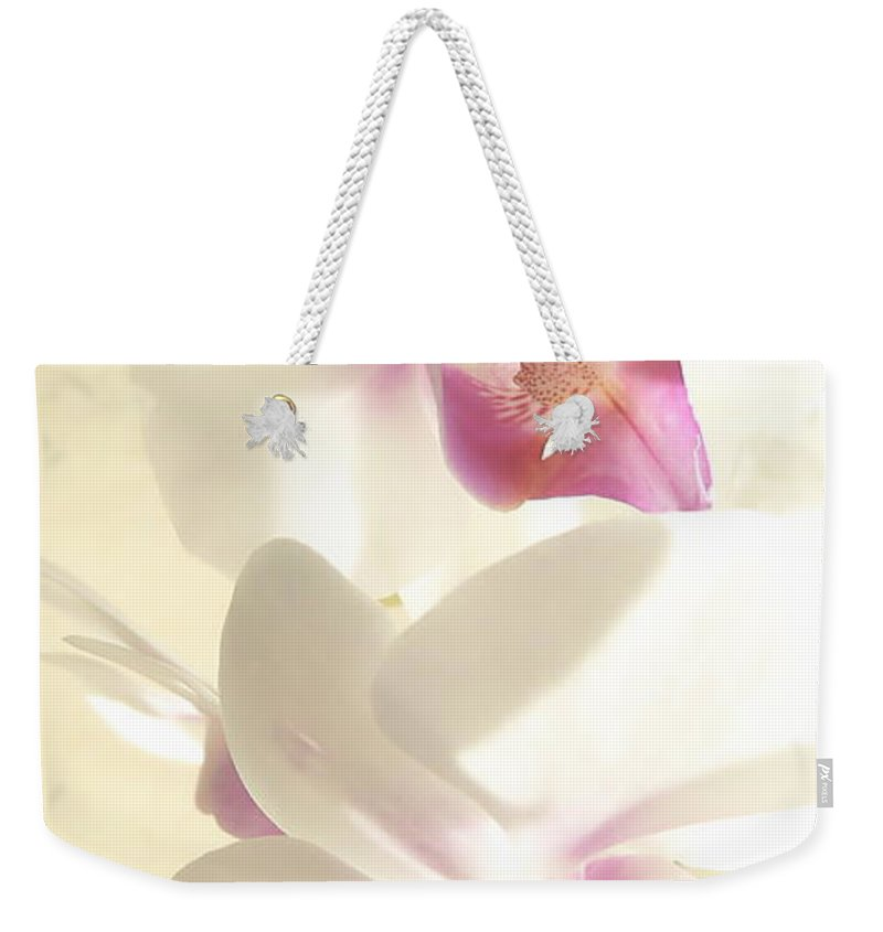 Orchids Weekender Tote Bag featuring the photograph Orchid's Glow by Kume Bryant