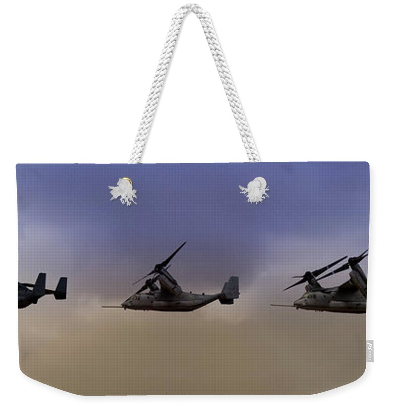 V22 Weekender Tote Bag featuring the photograph Osprey Transformation by Ricky Barnard