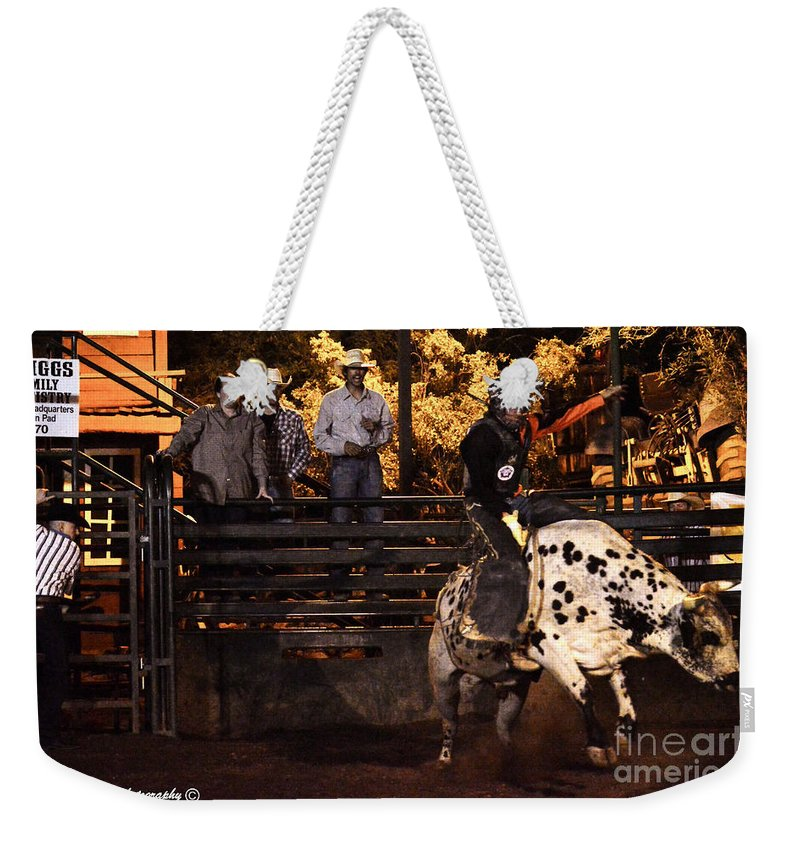 Bull Riding Weekender Tote Bag featuring the photograph Out Of The Gate by Tommy Anderson