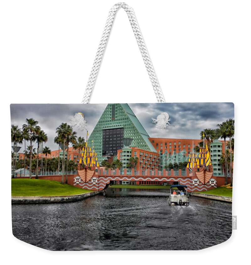 Magic Kingdom Weekender Tote Bag featuring the photograph Out Running The Storm At The Dolphin Resort by Thomas Woolworth