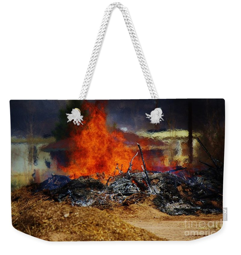 Fire Weekender Tote Bag featuring the photograph Out With The Old by Jessica Shelton
