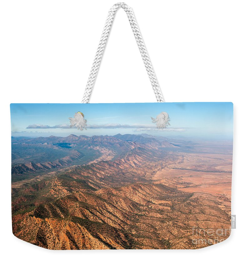 An Aerial View Of The Majestic Wilpena Pound In The Flinders Ranges National Park Weekender Tote Bag featuring the photograph Outback Ranges by Ray Warren