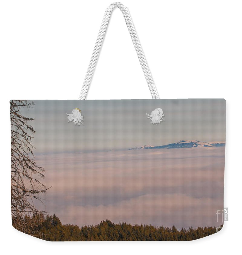 Clouds Weekender Tote Bag featuring the photograph Over The Clouds by Jivko Nakev