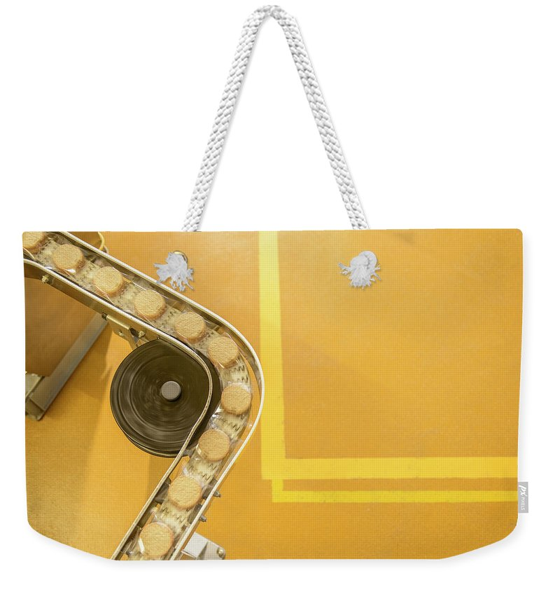 Manufacturing Equipment Weekender Tote Bag featuring the photograph Overhead View Of Freshly Made Biscuits by Monty Rakusen