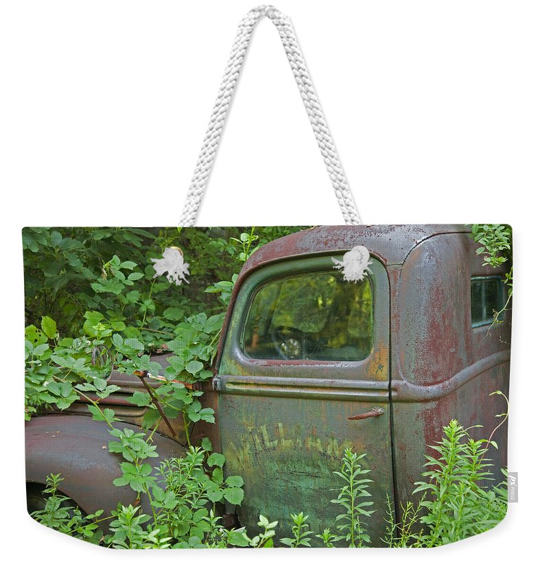 Rustbuckets Weekender Tote Bag featuring the photograph Overtaken by John Stephens