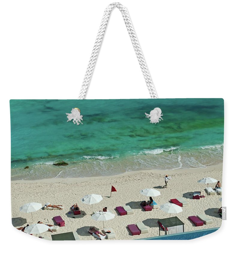 People Weekender Tote Bag featuring the photograph Overview Of Woman Swimming In Pool by Dallas Stribley