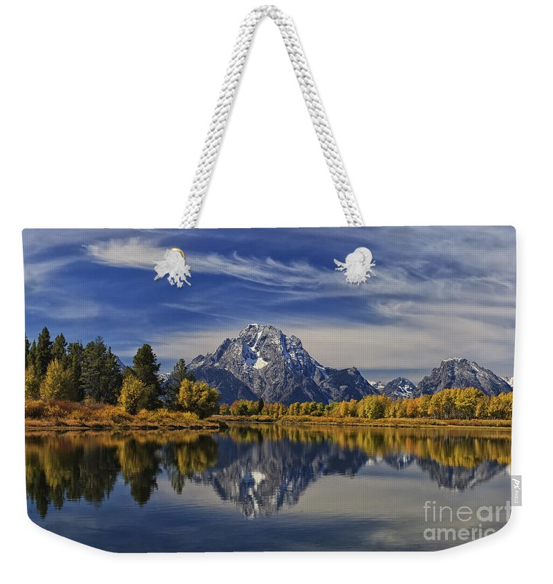 Grand Teton National Park Weekender Tote Bag featuring the photograph Oxbow Reflections by Mark Kiver