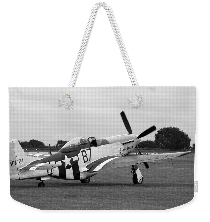 P51 Mustang Weekender Tote Bag featuring the photograph P51 Mustang by Robert Phelan