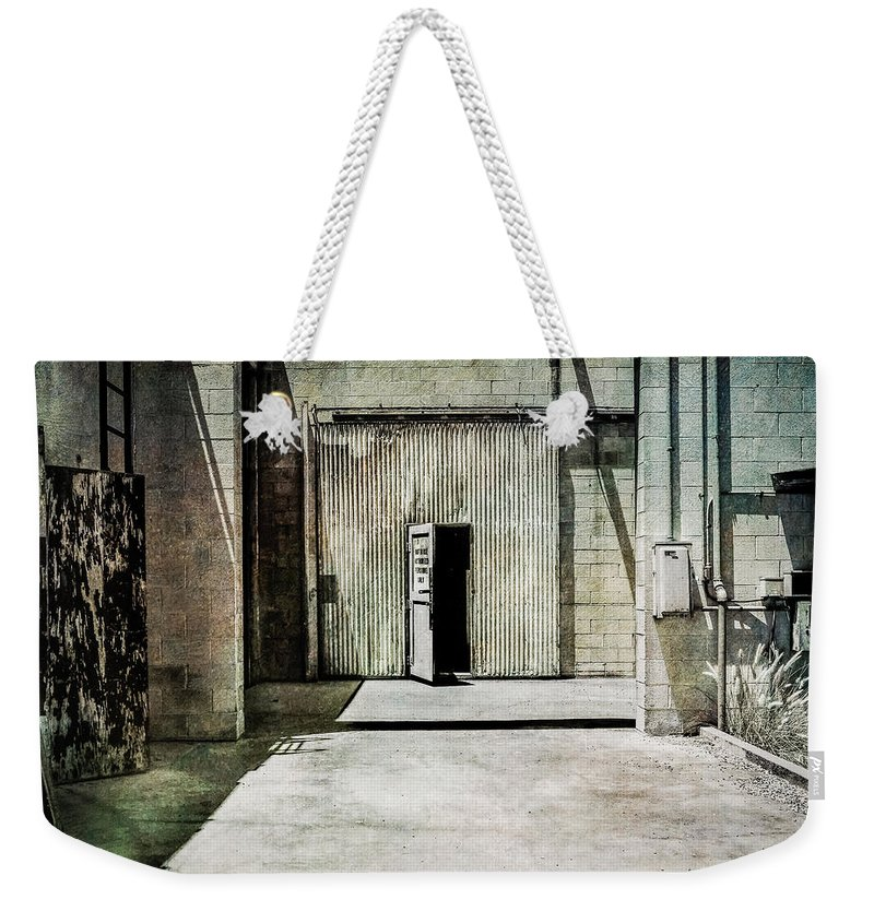 Abandoned Weekender Tote Bag featuring the photograph Pacific Airmotive Corp 28 by YoPedro