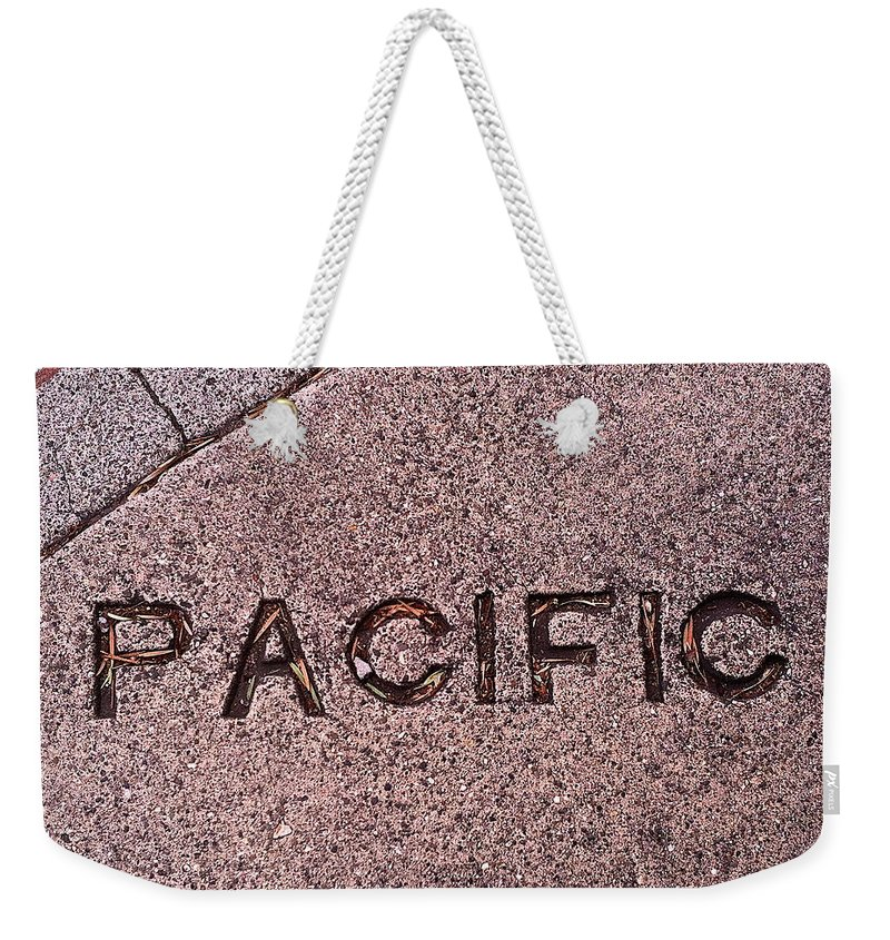 Pacific Weekender Tote Bag featuring the photograph Pacific Concrete Street Sign by Bill Owen